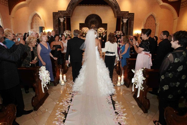 Long cathedral veil and petal-lined aisle runner