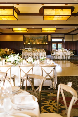 the lodge at torrey pines wedding reception ballroom neutral decor wood chairs white linens greenery