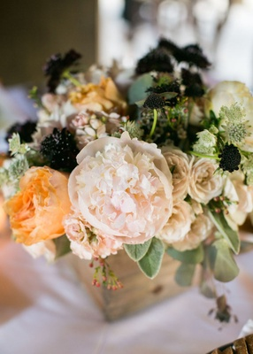 Ranch wedding reception table with wood box, pale pink & peach peonies & roses, greenery