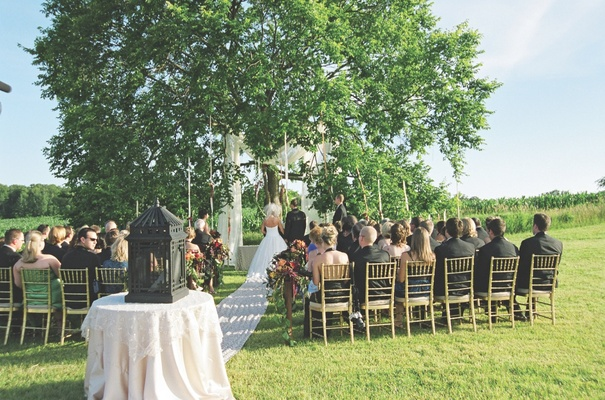 Alfresco ceremony under elm tree on grass