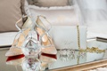 wedding accessories christian louboutin red bottom heels mesh jewels chanel perfume prada clutch