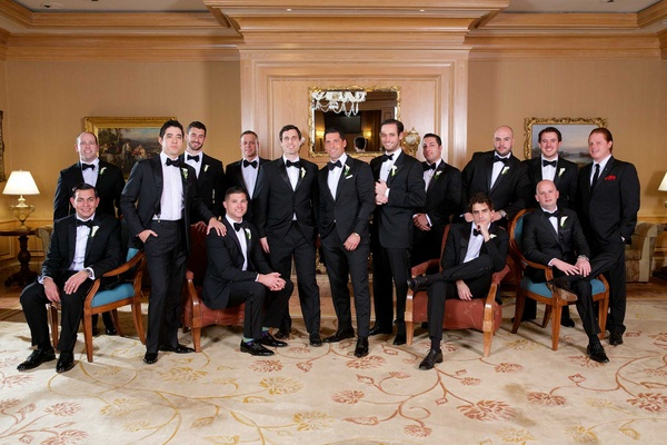 Chad Carroll with groomsmen in tuxedos and bow ties