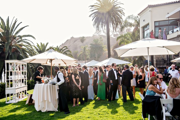Sunny cocktail hour outdoor at bel air bay club southern california wedding ideas umbrellas