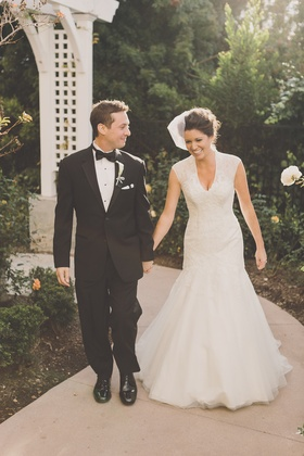 Bride in fit-and-flare gown with groom in tuxedo