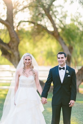 Bride in strapless Hayley Paige wedding dress and groom in tuxedo
