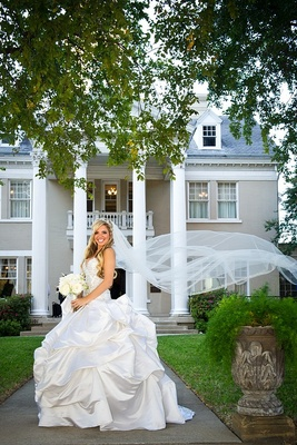 Bridal veil blowing in wind with pick-up ball skirt