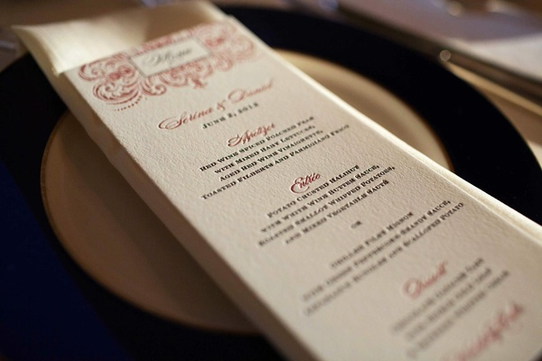 Wedding reception menu in elegant card stock and red accents