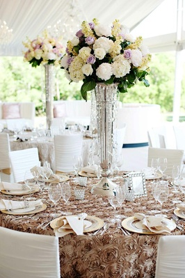 Rose linens on tent wedding table with tall centerpiece