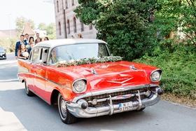 wedding getaway car transportation to ceremony red chevy chevrolet classic car