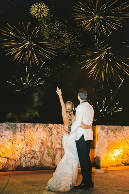 wedding reception firework show colombia wedding couple watching fireworks bride groom