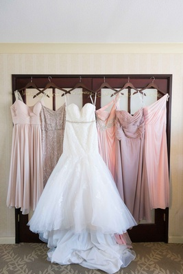 bride bridesmaids dresses hanging up different pink trumpet gown personalized hangers