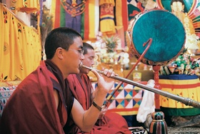 Townspeople from Bhutan performing with musical instruments