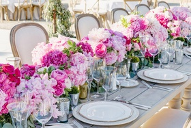Wood table decorated with lush pink flowers