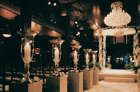 Candles and chandelier fill ceremony room