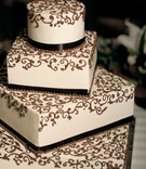 White four layer wedding cake with brown design
