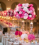 wedding reception gold stand pink hydrangea rose peony flowers floating candles rectangle table
