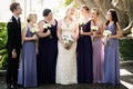 Bride in Willowby by Watters wedding dress bridesmaids in mismatched Alfred Angelo purple dresses
