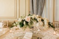 Wedding reception with paneled walls drapes neutral decor white hydrangea, greenery, pink ivory