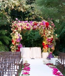 Flower chuppah at Hotel Bel-Air Swan Lake wedding ceremony with fresh pomegranate and citrus