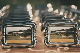 Cards in silver frames with date and table name