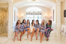 Bridesmaids in matching robes with bride