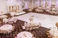 wedding reception at the legacy castle white dance floor and flowers gold seating accents royal