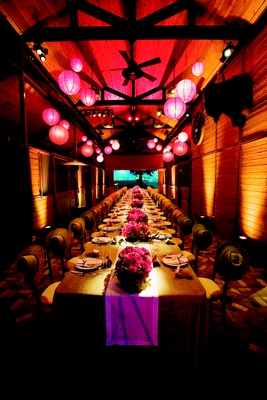 Long rectangular table with paper lanterns overhead