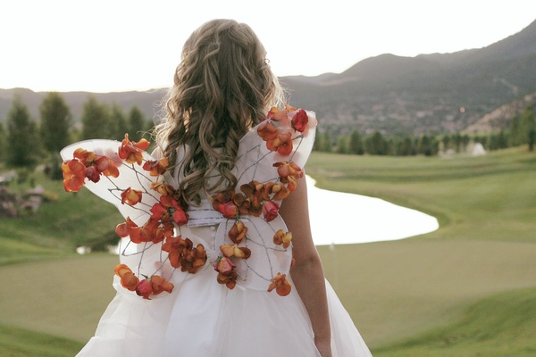 Flower girl wings decorated with rose petals