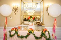 beverly hills bridal shower colorful theme pink red orange yellow flowers greenery cake table