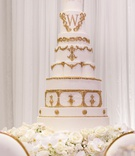wedding cake white frosting gold decor gold monogram design shannon perkins tahir whitehead nfl
