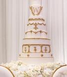 wedding cake white frosting gold decor gold monogram design shannon perkins tahir whitehead nfl