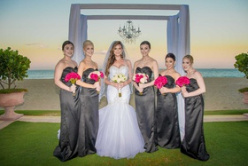 Bride in mermaid wedding dress with bridesmaids sweetheart necklines ocean ceremony view chandelier