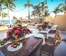 rustic wooden tablescapes with low colorful centerpieces lace runners at beach venue mexico