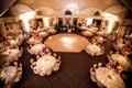 Reception room shot of round tables around dance floor