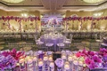 Wedding ballroom at Four Seasons Los Angeles with lush purple and pink flowers