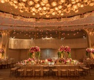 Wedding reception at the beverly hills hotel ballroom crystal chandelier with pink roses hanging