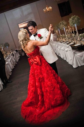 Brandon Wood dancing with bride in rosette gown