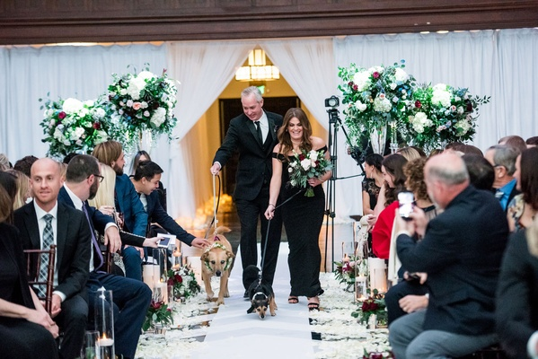 Wedding ceremony at vibiana drapery green flower arrangements dogs with flower collars ring bearer