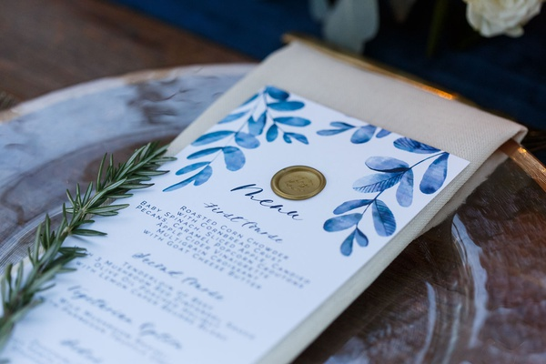 White and blue watercolor design motif menu card calligraphy gold wax seal sprig of rosemary herbs