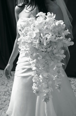 Black and white photo of cascading bouquet of orchids