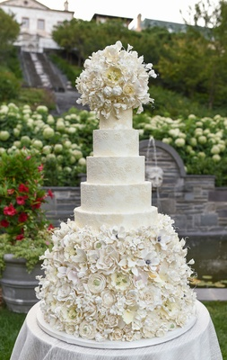 damask wedding cake with abundance of sugar flowers