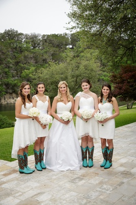 Bride in a strapless Nardos Imam dress with bridesmaids in mismatched Nardos Imam dresses