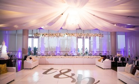 wedding reception brendan haywood dance floor head table white flowers overhead drapery tent