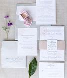 invitation suite with pink rose print, grey lettering and envelope, belly band