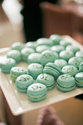 Blue-green French macaron cookies with initial P icing