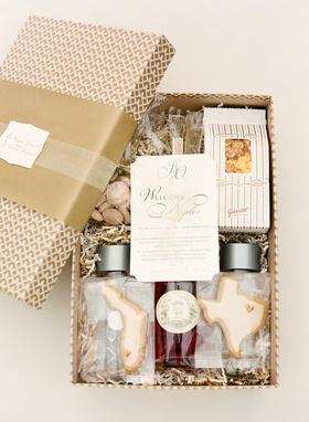 Wedding welcome box full of cookies, Garret's popcorn, water and rosé wine