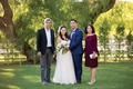 father of groom and mother of groom with couple santa susana california wedding ranch burgundy dress