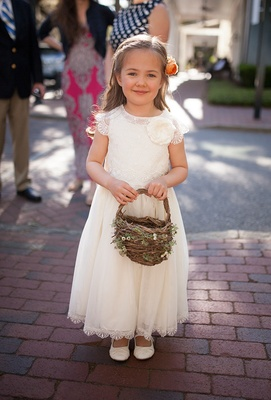 White flower girl dress short sleeves with slippers, flower in hair, twig and greenery basket