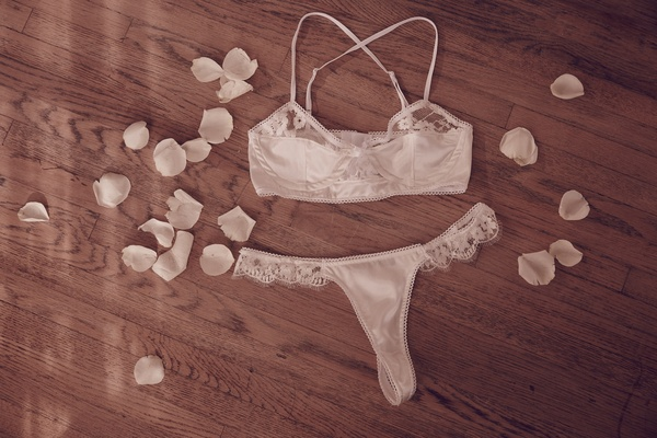 For Love & Lemons satin bra and thong with floral lace.