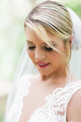 bridal makeup with magenta lipstick, full lashes, and a soft smokey eye